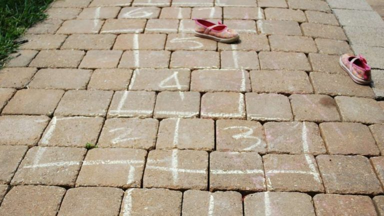 A classic hopscotch games drawn by a child on the sidewalk