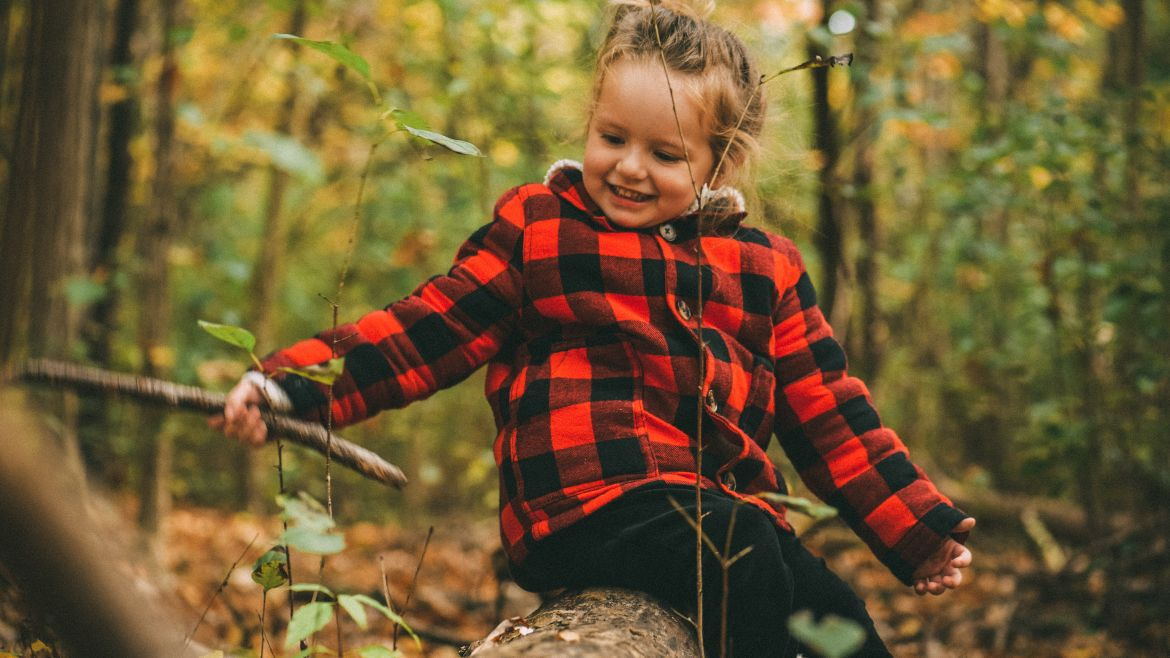 Girl plays in the forest.